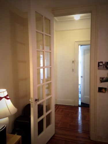 The other French door leading from the living room to the center hall.