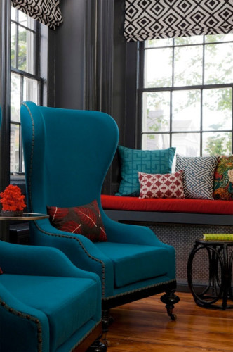 Although not quite my style, the teal and red are fabulous against the dark gray background.