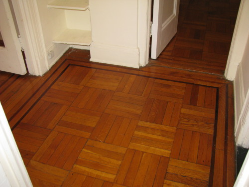 Amazing quarter-sawn oak floors with mahogany inlay to be even more amazing after we have then sanded and refinished.