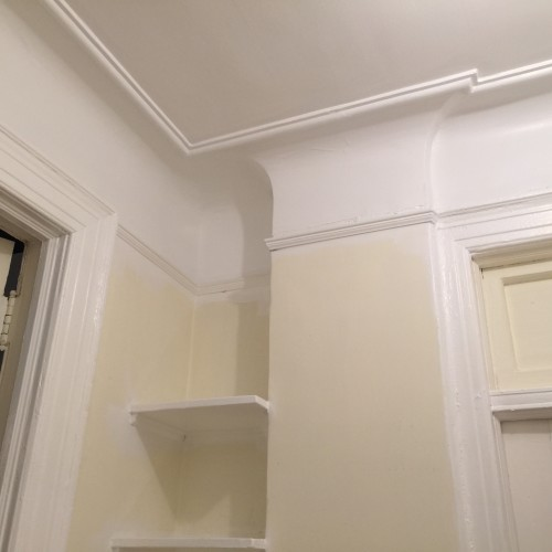Trim and plaster cove in Benjamin Moore Chantilly Lace White.
