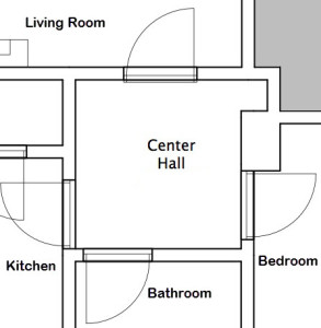 This is our Center Hall and it connects with the Living Room, Bedroom, Bathroom, and Kitchen. It also features a nice little niche with some shelves.