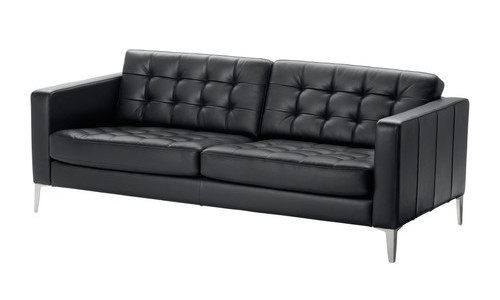 Ikea Karlstad sofa in black leather with aluminum legs. Simple, timeless, classic..... Except for those aluminum legs.