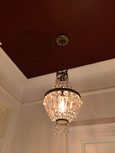 French crystal basket chandelier against red ceiling. So very good....