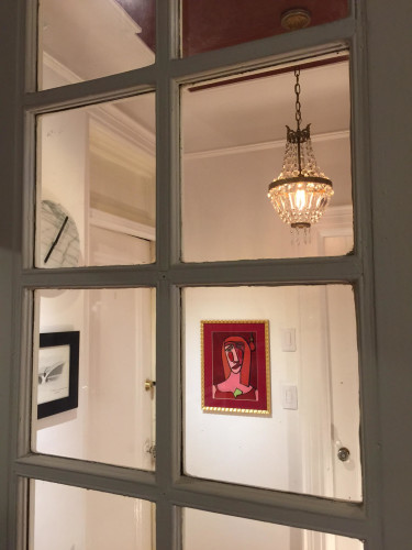 View of center hall from living room through one of our French doors.