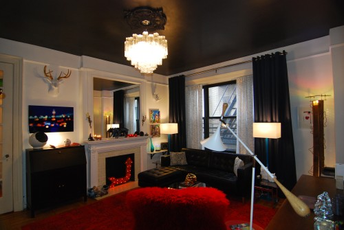 The fireplace may be the focal point, but the chandelier is truly the show stopper when you enter.
