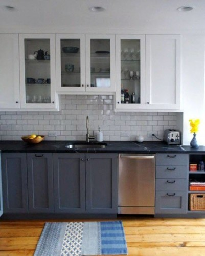 Apartment Therapy featured the full renovation of Dan Bailey's Boston kitchen last year. As it turns out, there are a few things here that we will likely be using in our kitchen, including the cabinet style, black soapstone counters, and yes... Subway tile.