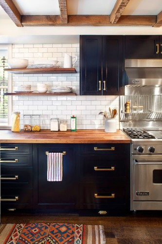 I have never been a fan of brass, but it just looks like it belongs in this kitchen and the overall idea of brass cabinet hardware seems to be the direction we want to head in our kitchen. You can see there is a theme going on here... Black, white, wood, brass... beautiful, although we will not be buying Viking range anytime soon.