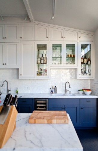 We both love this kitchen.... Especially the blue lower cabinets. I also think it is fabulous that they took the time to design the upper row to fit within the angle of the ceiling.