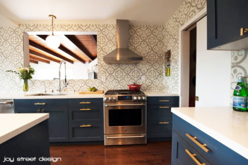There is a lot to love about this Boston kitchen featuring Ikea cabinet shells with painted DIY Shaker Semihandmade Doors. Of course the marble counter tops, brass hardware and dark blue cabinets are hitting all the right notes for me.