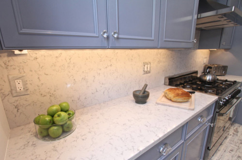 Quartz countertops can be beautiful as in the example of Silestone Lyra, which looks a lot like marble (but not quite).