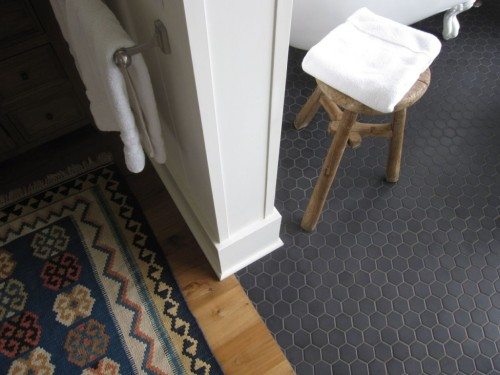 OK, so this is not a kitchen.... But that floor is really beautiful! Two inch matte black hexagons.... In doing a Google Search, I found several bathrooms with this floor, but not a single kitchen. Why not I ask?