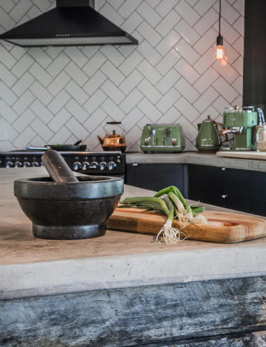 Inexpensive subway tile laid in a herringbone pattern is a great way to elevate a common material to a higher level while keeping it timeless and simple. [Image: Adrian Ramsay Design via Houzz]