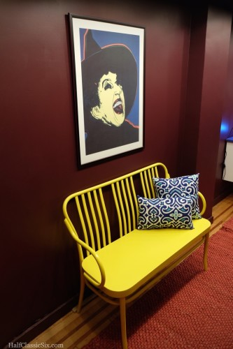 Andy Warhol's Wicked Witch has taken up company over our yellow bench which we purchased before we closed on the property.