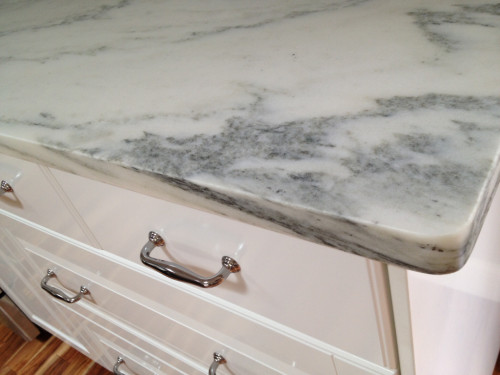 Honed marble is a risky choice according to some, but we are willing to accept the inherent risks of possible pitting, etching, and staining because, well, because that is what marble does. [Source: The Garden Web]