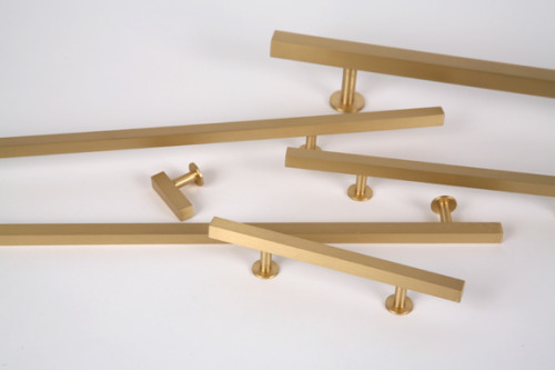 I have seen these Lewis Dolin brushed brass pulls on several blogs, and while I don't want to be a copy cat, I think they are the best choice for us. [Source: Lewis Dolin]