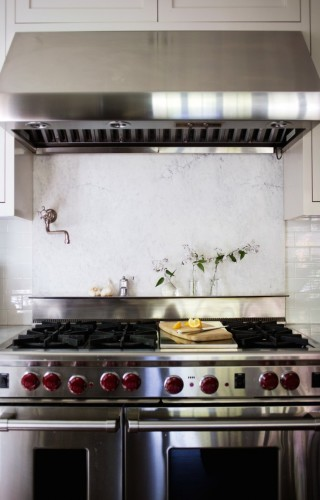 Although admittedly risky as far as keeping spills and stains away, adding a marble slab behind the stove is absolutely stunning. [Source: Remodelista]