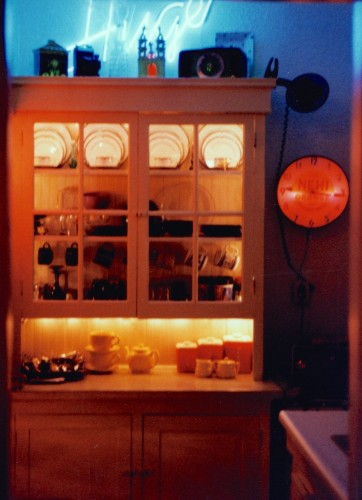 My Seattle kitchen in 1996, mini white Christmas lights strung inside vintage 1905 glass doored hutch. (I still have that vintage 1950s Nehi Clock, and hope to put it to good use in our new kitchen)