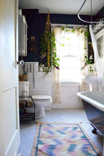This bathroom, while not quite like ours, is none the less an inspiration for ours. Essentially, I plan to play up our existing black and white tile scheme and make it work. [Source: Apartment Therapy]