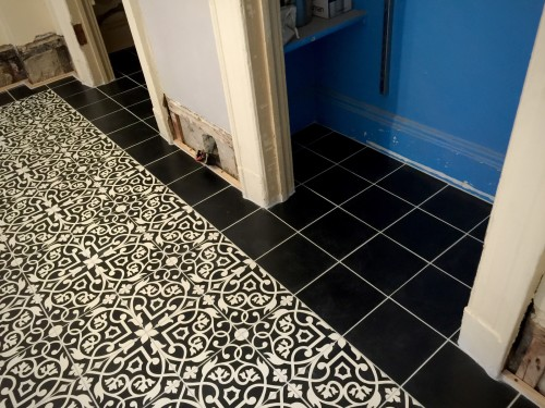 I wasn't sure how I felt about the light gray grout with the black tiles, but it is growing on me.