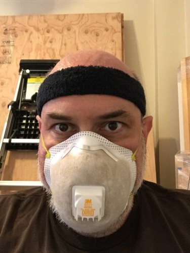 Yours truly sporting my dirty filthy dust mask after digging through cinders for three hours. Glad that brown stuff isn't in my lungs.