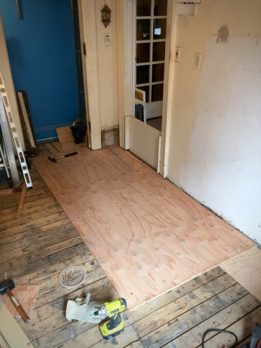 The first piece of subfloor is the most critical, which is why it took several hours cutting and fitting just right.