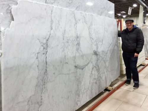 My handsome husband guarding the only slab of honed Carrara marble to be found in eastern New Jersey.