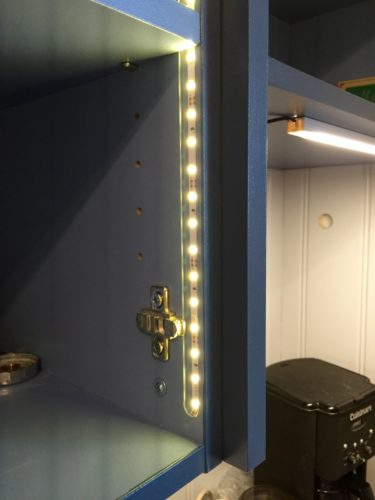 Close up of LED lighting installed inside the upper cabinets. By installing them just inside the door frame, they will light the front of the cabinet and won't be seen directly.