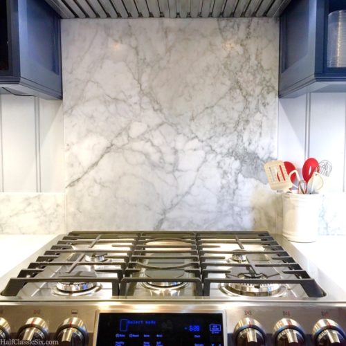 We chose the busiest part of the large slab of marble for the section behind the stovetop. Fortunately, they were able to cut the rest of the pieces needed from the area around this section.