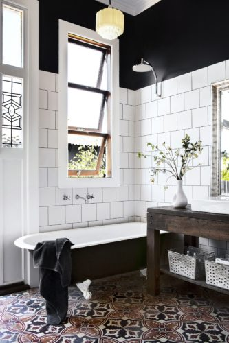I stumbled across this Australian bathroom and was immediately grabbed by the black upper walls with white tile lower walls. [Source: Homes to Love (AU)]